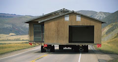 Prefab home en route (photo by Joe Sohm)