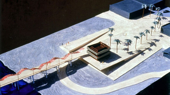Public plaza sloping down to the beach and up to the horizon, with renovated lifeguard tower, palm trees in an elliptical arc, bike path, and ribbon-like metal canopy