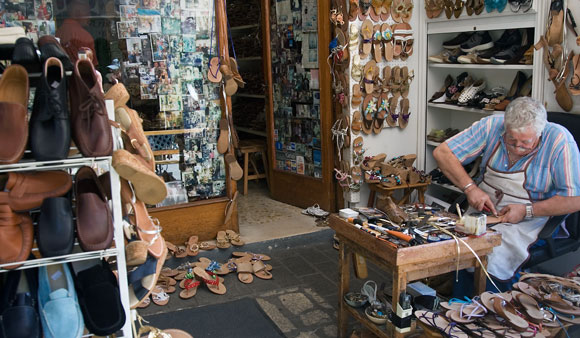 Even the art of making shoes requires customers, a cobbler in Capri, Italy (photo by Jorge Royan)