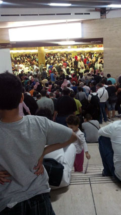Trapped in the Riyadh customs line at the King Khalid International Airport: an eight-hour wait, arms guards, no sitting, no talking, no food, no water, no sleeping, no restroom, no joking (photo by Anthony Poon)