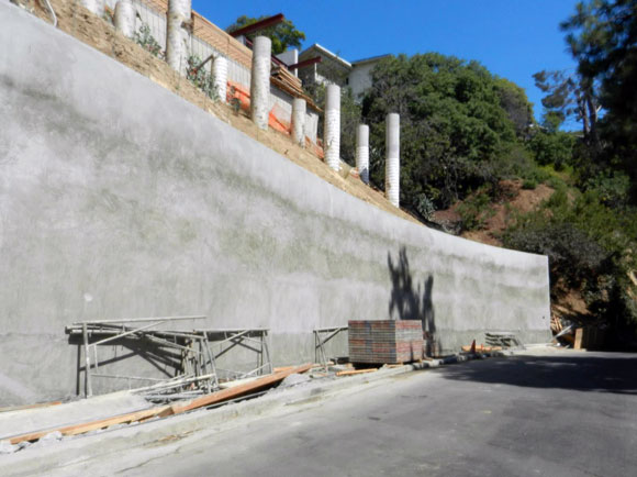 A most expensive eyesore: the neighbor's city-required retaining wall, (photo by Anthony Poon)