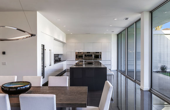 Dining and kitchen of Linea Residence G, Palm Springs, California, by Poon Design and Andrew Adler (photo by Mark Ballogg)